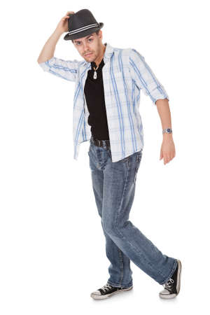 male dancer: Young dancer touching his hat and one arm outstretched
