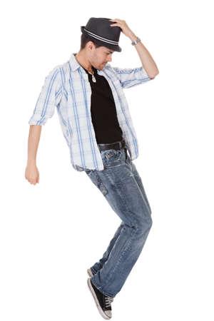gente bailando: Bailarín joven tocando su sombrero y un brazo extendido Foto de archivo