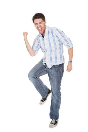 Casual handsome young man in jeans shouting for joy raising his hands above his head Stock Photo - 17384604
