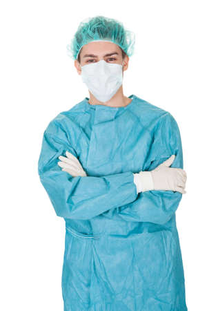 operation gown: Full body studio portrait of a young male surgeon Stock Photo