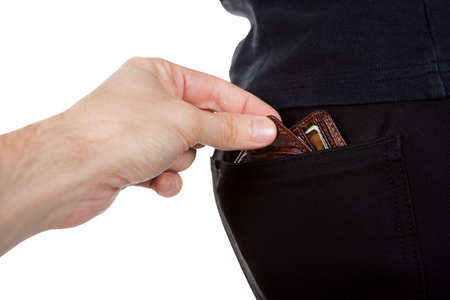 pick: Hand of a male pickpocket stretching out stealing a mans wallet from the back pocket of his trousers isolated on white