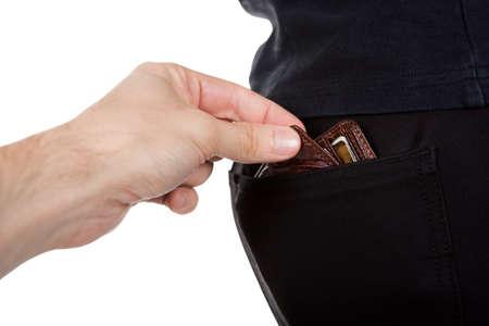 delincuencia: La mano de un carterista masculino que estira hacia fuera robar una billetera mans del bolsillo trasero de sus pantalones aislados en blanco