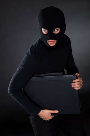 Hacker in disguise stealing data from Computer Stock Photo - 17384520