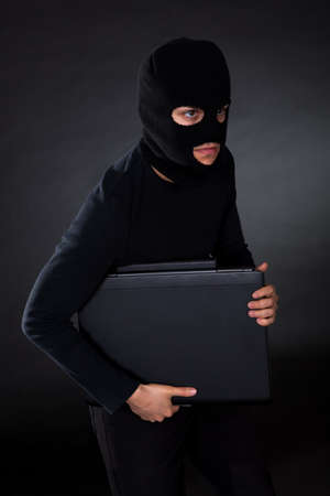 Hacker in disguise stealing data from Computer Stock Photo - 17384476