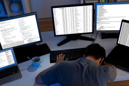 workaholic: Computer programmer sleeping in the office at night
