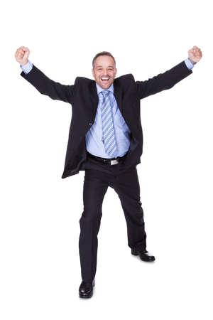 Happy Businessman Celebrating Success On White Background photo