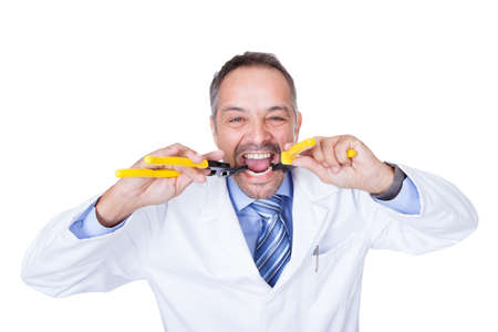 Smiling Male Doctor Holding Pliers On White Background photo
