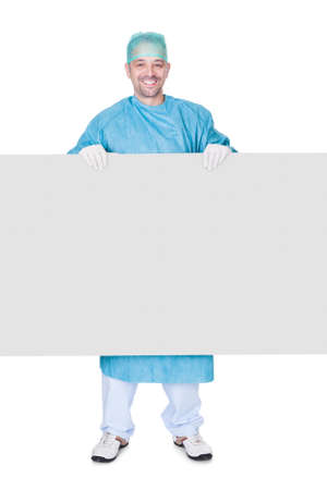 health care worker: Doctor In Operation Gown Holding Blank Placard On White Background