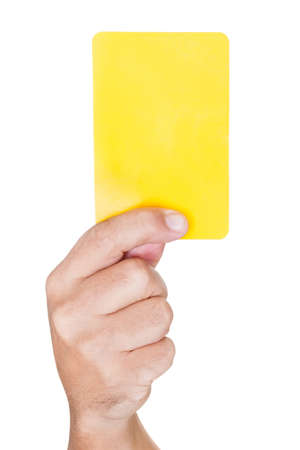 hand Of Soccer Referee Showing Yellow Card On White Background Stock Photo - 17501911