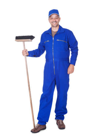 Happy Sweeper Cleaning Floor On White Background Stock Photo - 17501891