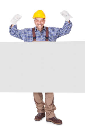 Portrait Of Happy Contractor Holding Placard On White Background Stock Photo - 17501908