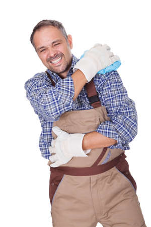 Construction Worker Suffering With Shoulder Pain On White Background Stock Photo - 17501888