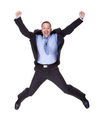businessman jumping: Businessman Jumping In Joy On White Background Stock Photo