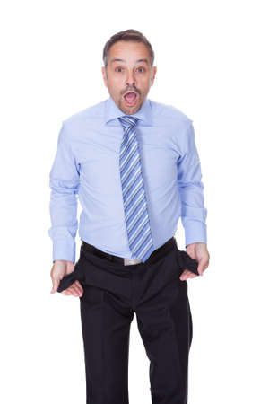 lost money: Businessman Showing Empty Pockets On White Backgrounds Stock Photo