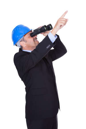 hard to find: Male Architect Looking Through Binoculars On White Background