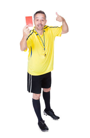 Soccer Referee Showing Red Card On White Background Stock Photo - 17626403