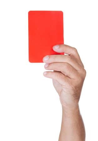 de hand van voetbal Scheidsrechter Resultaat Rode kaart op witte achtergrond Stockfoto