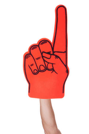 Close-up Of Hand Wearing Foam Finger Isolated On White Background photo