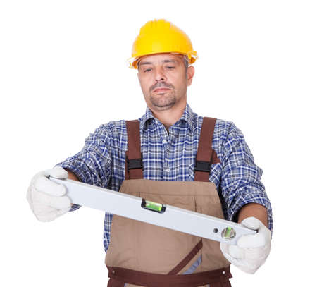 Portrait Of Technician Looking At Level Isolated On White Background Stock Photo - 17626297
