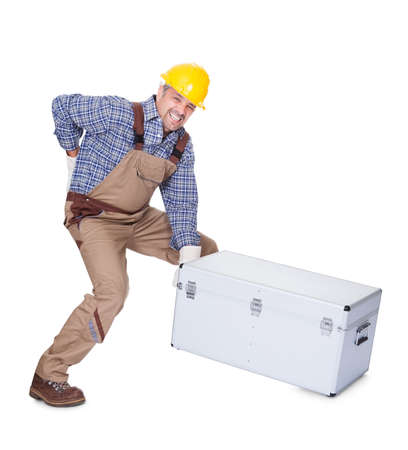 Man With Back Pain Lifting Metal Box Isolated On White Background photo