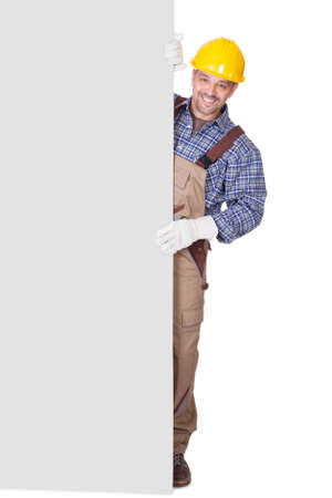 Portrait Of Happy Contractor Holding Placard On White Background photo