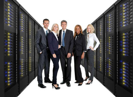 computer centre: Businessteam standing on front of two lines of server racks. Isolated on white background