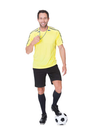 Soccer judge standing with ball. Isolated on white background photo