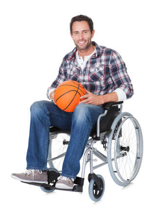 disabled sports: Man in wheelchair with basketball. Isolated on white
