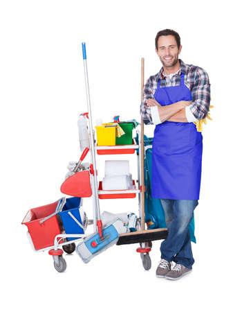 servicio domestico: El hombre del servicio de limpieza profesional. Aislados en blanco Foto de archivo