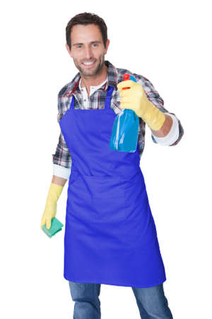 messy house: Portrait of a man with sponge and spray ready to clean windows. Isolated on white