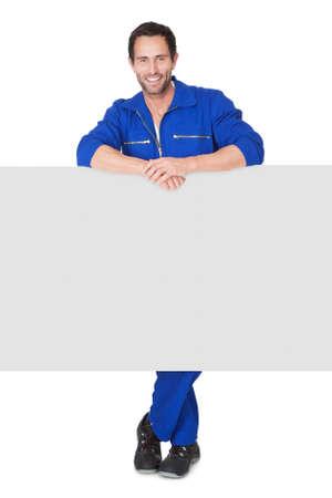 car mechanic: Portrait of happy automechanic. Isolated on white Stock Photo