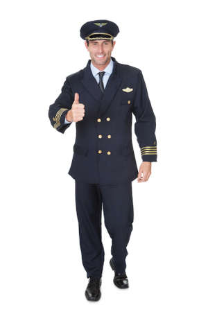 Portrait of confident pilot. Isolated on white photo