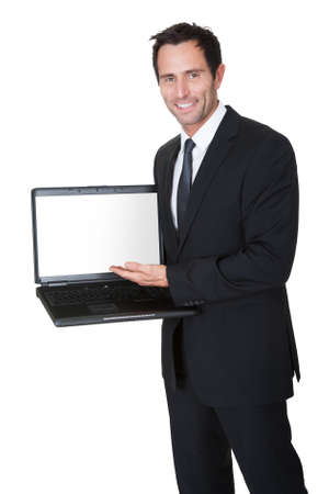 Happy middle aged businessman with laptop. Isolated on white Stock Photo - 17626329