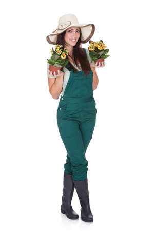 Beautiful Happy Woman Holding Flower Plant. Isolated On White Stock Photo - 17626350