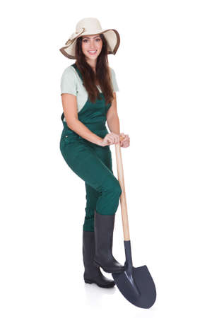 Beautiful Woman Holding Plant And Gardening Shovel. Isolated On White Stock Photo - 17626343