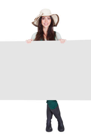 Pretty Woman Holding Blank Placard. Isolated On White Stock Photo - 17626423