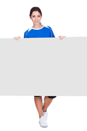 Sporty Woman Holding Blank Placard. Isolated On White photo