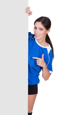 Sporty Woman Holding Blank Placard. Isolated On White Stock Photo - 17626327