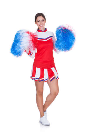 pom pom: Happy Smiling Cheerleader. Isolated On White Background Stock Photo