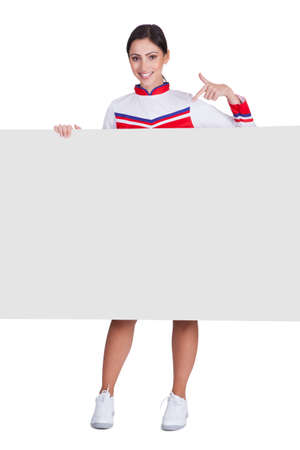 Cheerleader Pointing On Blank Placard. Isolated On White photo