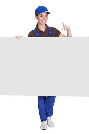 Smiling Female Plumber Holding Placard. Isolated On White photo