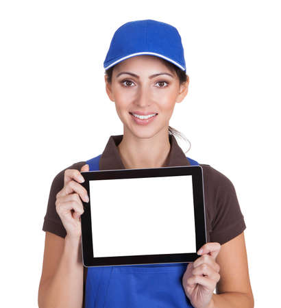 Smiling Female Plumber Holding Digital Tablet. Isolated On White photo