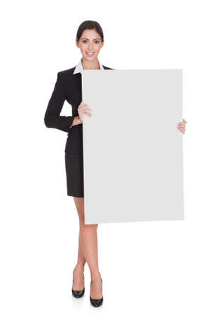a placard: Happy Smiling Young Business Woman Holding Blank Placard. Isolated On White Stock Photo