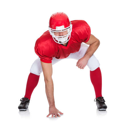 Portrait of American Football player. Isolated on white Stock Photo