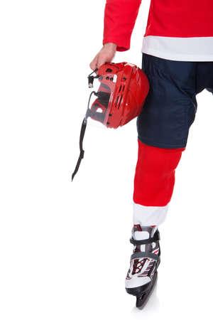Profesional hockey jugador tras partido. Aislados en blanco