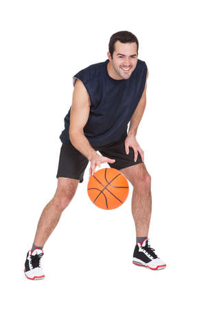 dribble: Professional basketball player with ball. Isolated on white