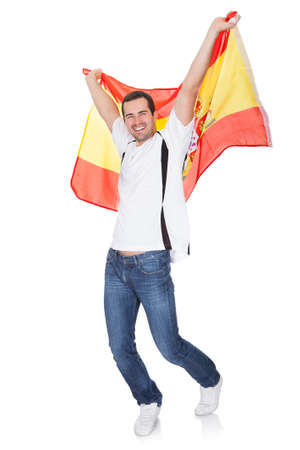 soccer fan: Portrait Of A Happy Man Holding An Spanish Flag. Isolated on white Stock Photo