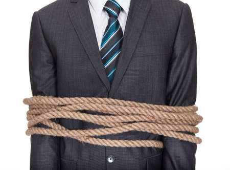 Businessman tied up in rope. Isolated on white photo