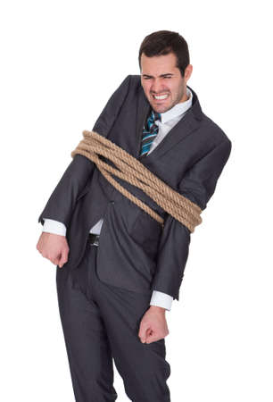 Businessman tied up in rope. Isolated on white Stock Photo - 17626271