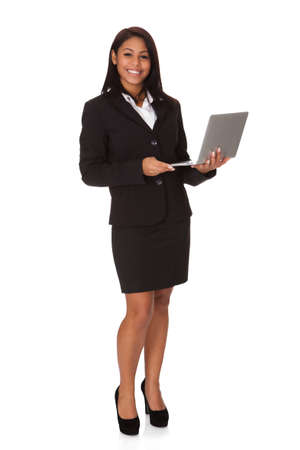 Businesswoman Holding Laptop. Isolated on white background Stock Photo - 17630192